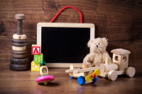 Childrens toys, teddy bear and blackboard