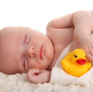 baby sleeping with rubber duck