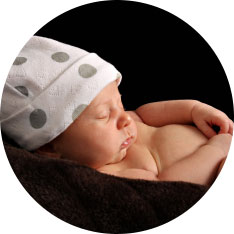 sleeping baby in spotted hat