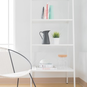 chair next to simple bookcase